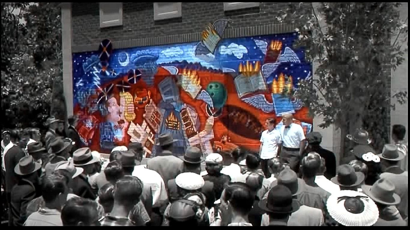 ビルとデイビッドが警察署の壁に描いた作品に反発する人々